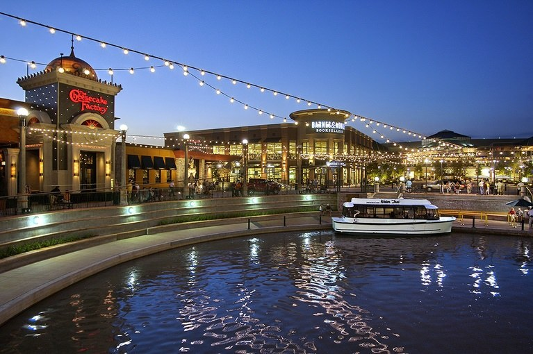 Outside The Woodlands Mall is light up by string lights as guests are seen waiting for the Water Taxi.